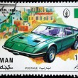 Stock Photo: AJMAN - CIRC1971: stamp printed in one of emirates in United Arab Emirates shows muscle car Maserati Indy, series, circ1971