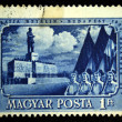 Stock Photo: HUNGARY - CIRC1951: Stamp printed in Hungary shows May Day demonstration in Budapest against backdrop of monument to Joseph Stalin, circ1951