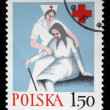 POLAND - CIRCA 1970s: A stamp printed in Poland shows medical sister helps the elderly woman, circa 1970s — Stock Photo