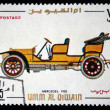Royalty-Free Stock Photo: UMM AL QIWAIN - CIRCA 1968: A stamp printed in one of the emirates in the United Arab Emirates shows vintage car Mercedes - 1902 year, full series - 48 of stamps, circa 1968