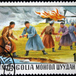 Stock Photo: MONGOLIA- CIRC1977: stamp printed in Mongolishows Mongols extinguish fire by passing buckets of water to each other, series, circ1977