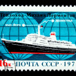 USSR - CIRCA 1973: A stamp printed in the USSR shows motor ship Mikhail Lermontov in the background of the scheme route Leningrad - New York, circa 1973 - Stock Photo