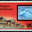 CENTRAL AFRICAN EMPIRE - CIRCA 1977: A stamp printed in Central African Empire (in present time Republic) shows postage stamp of airship on background of Museum of Sciense and Industry Chicago, USA, c — Stock Photo #12168484