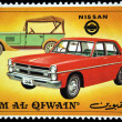 Stock Photo: UMM AL QIWAIN - CIRC1971: stamp printed in one of emirates in United Arab Emirates shows vintage Nisscars,series, circ1971