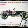 Постер, плакат: UMM QIWAIN CIRCA 1968: A stamp printed in one of the emirates in the United Arab Emirates shows vintage car Oldsmobile 1910 year full series 48 of stamps circa 1968