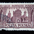 POLAND - CIRCA 1950s: A stamp printed in Poland is devoted to the five hundredth anniversary from the date of returning from Pomorze shows view of Olsztyn circa 1950s — Stock Photo