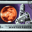 HUNGARY - CIRCA 1974: A Stamp printed in Hungary shows monitoring Mars with the Palomar Observatory, circa 1974 - Zdjęcie stockowe
