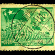 Stock Photo: CHIN- CIRC1949: stamp printed in Chinshows march of Peoples Liberation Army under image of Mao and Zhu, circ1949