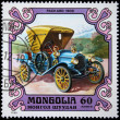 Royalty-Free Stock Photo: MONGOLIA - CIRCA 1980: A stamp printed in the Mongolia shows vintage automobile Packard 1909 year, one stamp from series, circa 1980