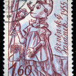 Постер, плакат: CZECHOSLOVAKIA CIRCA 1955: A Stamp printed in Czechoslovakia shows draw of Pinocchio with gold key and accompanied by dog circa 1955