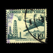 CHILE - CIRCA 1950s: A stamp printed in Chile shows plane on the background of oil rigs, circa 1950s — Stock Photo