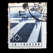 CHINA - CIRCA 1953: A stamp printed in China shows plane on the runway at the background of the sea, circa 1953 - Stock Photo