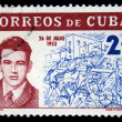 Stock Photo: CUB- CIRC1962: stamp printed in Cubshows portrait of Abel Santamarion background of assault on Moncadbarracks 26 July 1953, circ1962