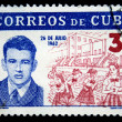 CUBA - CIRCA 1962: A stamp printed in Cuba shows portrait of Abel Santamaria on the backgound of pupils of 26 July school, circa 1962 - Stock Photo