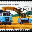 Stock Photo: GERMANY - CIRC1975: stamp printed in Germany shows pressing straw machine, circ1975
