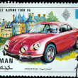 AJMAN - CIRCA 1971: A stamp printed in one of the emirates in the United Arab Emirates shows muscle car Renault Alpine 1300 85, series, circa 1971 — Stock Photo #12169719