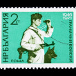 Stock Photo: BULGARI- CIRC1971: stamp printed in Bulgarishows frontier guard with dog, circ1971