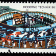 DDR - CIRCA 1975: A stamp printed in DDR (Eastern Germany) shows Rotary apparatus for milking cows, circa 1975 - Stock Photo