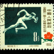 CHINA - CIRCA 1955: A stamp printed in China shows runner, circa 1955 - 图库照片