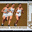 MONGOLIA - CIRCA 1980: A stamp printed in Mongolia shows runners, circa 1980 - 图库照片