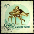 HUNGARY - CIRCA 1956: A Stamp printed in Hungary shows running hurdles, circa 1956 - 图库照片