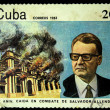 Stockfoto: CUB- CIRC1983: stamp printed in Cubshows Salvador Allende on background of burning palace Moncada, circ1983