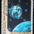 Stock Photo: LAOS- CIRC1984: stamp printed in Laos shows satilite Luna-1, circ1984