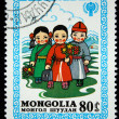 Stock Photo: MONGOLI- CIRC1980: stamp printed in Mongolishows schoolboys, circ1980.