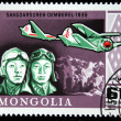 MONGOLIA - CIRCA 1978: A stamp printed in Mongolia shows pilots Shagoarsuren and Demberel - 1935, circa 1978 - Stock Photo