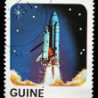 GUINEA-BISSAU - CIRCA 1983: A stamp printed in Guinea-Bissau shows Shuttle start, circa 1983 - Stock Photo