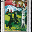 MONGOLIA - CIRCA 1975: A stamp printed in Mongolia shows Two dogs bark at a trot, sitting on a tree, and in the distance a hunter horse aims at her with a gun, circa 1975 — Stock Photo