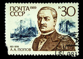 USSR - CIRCA 1989: A Stamp printed in the USSR shows Portrait of A.A. Popov, 1821-1898, with the Pyotr Veliky battleship and the Vice-admiral Popov armored ship in the background, circa 1989. — Stock Photo