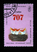 USSR - CIRCA 1989: A stamp printed in the USSR shows bank account of Soviet Children Fund and nest with three chicks with open beaks, circa 1989 — Stock Photo