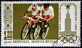 MONGOLIA - CIRCA 1980: A stamp printed in Mongolia shows bicyclists, circa 1980 — 图库照片