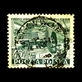 POLAND - CIRCA 1953: A stamp printed in Poland shows production of a car on a conveyor, circa 1953 — Stock Photo