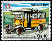 "PARAGUAY - CIRCA 1976: A stamp printed in Paraguay shows bus with the words ""US Mail"", circa 1976 — Stock Photo"