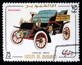 UMM AL QIWAIN - CIRCA 1968: A stamp printed in one of the emirates in the United Arab Emirates shows vintage car Cadillac - 1902-1903 year, full series - 48 of stamps, circa 1968 — Stock Photo