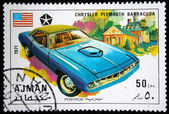 AJMAN - CIRCA 1971: A stamp printed in one of the emirates in the United Arab Emirates shows muscle car Chrysler Plymouth Barracuda, series, circa 1971 — Stock Photo