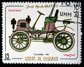 UMM AL QIWAIN - CIRCA 1968: A stamp printed in one of the emirates in the United Arab Emirates shows vintage car Columbia - 1901 year, full series - 48 of stamps, circa 1968 — Stock Photo