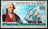REPUBLICA MALAGASY - CIRCA 1976: A stamp printed in Madagascar shows Comte de Grasse and ship Randolph, circa 1976 — Stock Photo