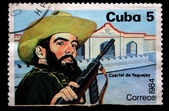 CUBA - CIRCA 1984: A stamp printed in Cuba shows Cuban revolutionary with a gun against the barracks, circa 1984 — Stock Photo