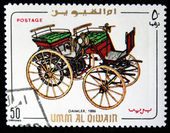 UMM AL QIWAIN - CIRCA 1968: A stamp printed in one of the emirates in the United Arab Emirates shows vintage car Daimler - 1886 year, full series - 48 of stamps, circa 1968 — Stock Photo