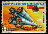 USSR - CIRCA 1978: A stamp printed in the USSR devoted to the Soviet-Polish cooperation in the Intercosmos program shows a spaceship being taken to the launch pad, circa 1978 — Stock Photo