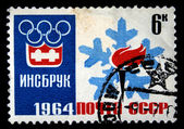 USSR - CIRCA 1964: A stamp printed in the USSR shows emblem of Olympics in Innsbruck, Austria, circa 1964 — ストック写真