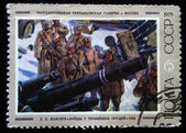 USSR - CIRCA 1975: A stamp printed in the USSR shows draw by artist Eugene Lanceray - soldiers near the captured guns, circa 1975 — Stock Photo
