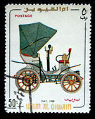 UMM AL QIWAIN - CIRCA 1968: A stamp printed in one of the emirates in the United Arab Emirates shows vintage car Fiat - 1900 year, full series - 48 of stamps, circa 1968 — Stock Photo