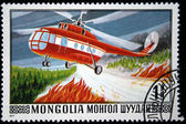 MONGOLIA- CIRCA 1977: A stamp printed in Mongolia shows Fire helicopter over the forest, series, circa 1977 — Stock Photo