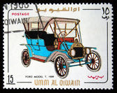 UMM AL QIWAIN - CIRCA 1968: A stamp printed in one of the emirates in the United Arab Emirates shows vintage car Ford model T - 1909 year, full series - 48 of stamps, circa 1968 — Stock Photo