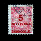 GERMAN EMPIRE - CIRCA 1930s: German postage stamp with the number 5 millions in the center, circa 1930s — Stock Photo