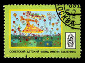 USSR - CIRCA 1989: A stamp printed in the USSR shows childs draw of a girl in the meadow, series devoted Sovet Children Fund, circa 1989 — Stock Photo